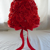 Red Rose Wedding Cake this is a three teir stacked cake, fruit, choc & lemon, covered with over two hundred handcrafted red roses and a few scattered faux...