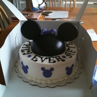 Mickey Mouse This was for a bridal shower for a huge Mickey fan that was getting married in Disney World. 10 inch round with half ball pan cake on top....