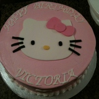 Hello Kitty Chocolate cake covered in buttercream with fondant details.