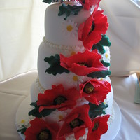 Military Poppy Wedding Cake A Poppy wedding cake for a bride and her military groom. My first attempt at the poppies was a failure but I ended up getting the hang of...