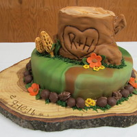 Non Traditional Tree Stump Camo Wedding Cake  The bride and groom were having a small wedding and wanted a small cake with the tree stump for the topper. The morel mushrooms are made of...