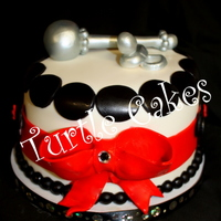 Elegant Baby Minnie Mouse Baby Shower Fondant silver rattle and pacifier top this simple yet elegant Minnie Mouse Cupcake Tower cake with 24 matching cupcakes. TFl :-)
