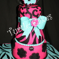 "Sweet ""striped"" 13Th Birthday 10"", with 8"" and 6"" carved bodice on top; white with oreo filling, orange dream and strawberry fondant bow and toppers"