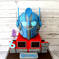 "Transformers Optimus Prime 3D Helmet Cake Transformers Optimus Prime Helmet cake based on the voice changer helmet toy. This is all cake with an 8"" square tier and a 6""..."