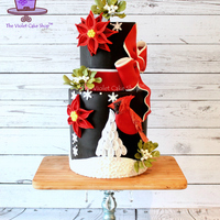 Christmas Cardinal, Stylized Poinsettia & Sugar Mistletoe Cake Hoping everyone has had a VERY Merry Christmas and are enjoying their holidays so far! Here is my family Christmas cake for this year for...