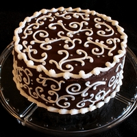 Chocolate And White Scroll Cake