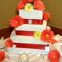 Gerber / Gerbera Daisy Wedding Cake This was my first ever wedding cake, so I was thankful the bride chose a more simple, yet elegant design. 12, 8, 6 inch squares stacked....