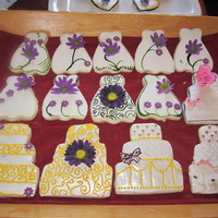 Bridal Shower Cookies sugar cookies, frosted then decorated with fondant. Topped cookies with gumpaste flowers.