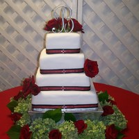 Square Wedding Cake I used real ribbon w/rhinestones in center. Real flowers used on cake and around base