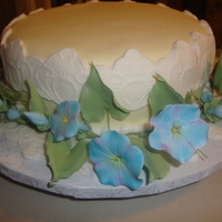 Morning Glory / House Warming lemon zest cake with fondant and gumpaste flowers.