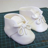 Baby Booties  Gumpaste/fondant booties. I saw the cutters for these and though I would save myself a few bucks and made my own cardboard patterns. Turned...