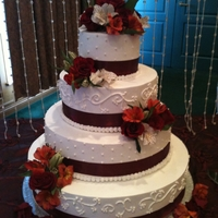 Burgundy Wedding Cake This is a round wedding cake I made. The sizes are 6,10,14, & 18. Ribbon with fresh flowers.