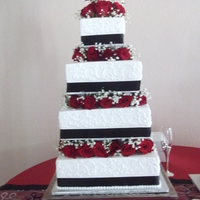 Black, White, And Red Rose Cake This was a four teir square cake made for our dear friends wedding. It is a 14, 12, 10, & 6 inch square cake. It took four dozen roses...