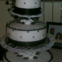 Black & White Wedding Cake This is my third wedding cake..this was for my cousin..flavors lemon.butter and red velvet with buttercreme..