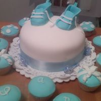 Baby Shower   Fondant shoes, and cupcakes over white cake and butter cream frosting.