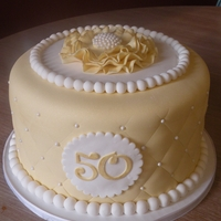 "50Th Anniversary Cake 8"" cake for a 50th anniversary. This was also my first ruffle flower and I love it! :)"