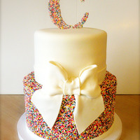 Rainbow Sprinkles Wedding Cake Small wedding cake made for a wedding with a rainbow theme. Bottom tier and initial C are both completely coated in rainbow non-pareils. I...