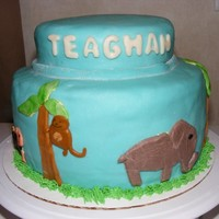 Jungle Cake 2 tier cake, MMF covering. Animals all around the cake