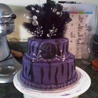 Zebra And Purple 2 layer cake with fondant accents and feather and beading coming from top