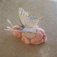 "Baby Butterfly One of a series of ""dressed up"" gumpaste babies. I'll either use these on an upcoming baby shower cake...or I'll..."