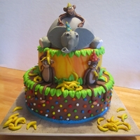 Jungle Cake 2nd birthday cake designed to match invitation/plates/napkins/etc. Everything made of fondant or fondant with tylose mixed in.