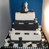 Chess Battle I entered this cake in 2011 NCACS. Gumpaste chess pieces were made using a chocolate mold and squares are also gumpaste. Everything else is...