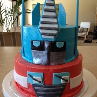 Optimus Prime Vanilla cake with buttercream icing and fondant accents with luster dust for metallic look. Thank you to cake central artists for...