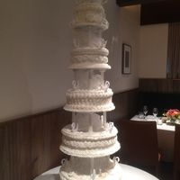 1970's Style Tiered Wedding Cake With Pillars And Bows- Buttercream This wedding cake was made for a 45th wedding anniversary. It was originally meant to be a replica of the original 1970 wedding cake, but...