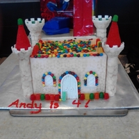Candy Castle Cake Covered With White Modeling Chocolate (Chocolate Clay) My son really wanted a candy castle cake for his birthday... He could hardly believe that he could have candy on top of cake *lol* it was a...