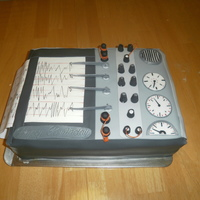 Spy Cake / Lie Detector Machine Cake I invented this cake after looking at dozens of pictures of lie detector tests online. It isn't an exact replica of any of them, but I...