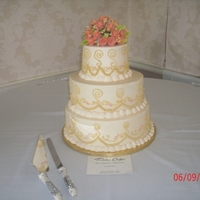 Sugar Roses Wedding Cake Red Velvet covered with White Chocolate Fondant, BC scrollwork and sugar roses.