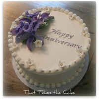 "Purple Anniversary Buttercream cake with gumpaste flowers and silver dragee accents. I donated a ""gift certificate"" for a silent charity auction for..."