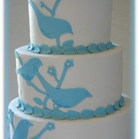 Elle's Bird Sillouhette Cake Blue bird sillouhette cake with blue branches, leaves and flowers. Red Velvet and White Chocolate Cake with vanilla buttercream. The Bride...