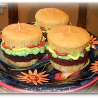 "A Plate Of ""sliders"" Hamburger Slider cupcakes - butter cake with brownie ""hamburger patties"", buttercream mustard, ketchup and lettuce. These were so..."