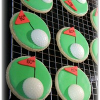 Golf Cookie Favors NFSC with royal icing, fondant flags and white chocolate golf balls. These were made as party favors for an 80th Birthday Party.