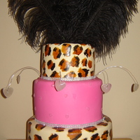 Luscious Leopard And Feathers THIS CAKE HAD 2 TIERS LEOPARD PATTERN HAND PAINTED. HOT PINK THE MIDDLE TIER, WITH SUGAR DIAMONDS, DANGLING HARD SUGAR CANDY DIAMONDS....