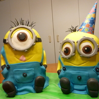 Two Little Minionsone Is 5 Layers And Other Is 4 Layers Of Chocolate Cake Covered In Chocolate Ganachethen Cavered In Mmf   Two little Minions...one is 5 layers and other is 4 layers of chocolate cake covered in chocolate ganache...then cavered in MMF