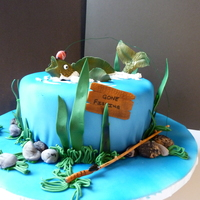 Gone Fishing   this was fun to make, the fish, etc is all made with gumpaste. Cake is covered with MMF