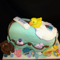 Diaper Bag Cake chocolate cake covered with MMFAll items are make of gumpaste