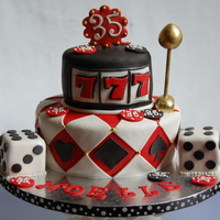 Casino Cake This fabulous Custom Designed Casino Cake was ordered for a client's 35th Birthday.Color scheme for the party - Red, Black and White....
