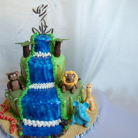 Jungle Themed Cake This adorable cake was made for a very special little boy who turned ONE!Rich Dark Chocolate cake layered with smooth and delicious creamy...