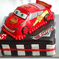 Disney Pixar Cars Cake This cake was custom designed for a 5 year old Cars fan! This adorable 3D Lightning McQueen cake is from the Pixar/Disney movie Cars....