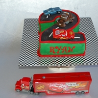 Disney Cars Cake This cool Disney CARS cake was made for a 2 year old who is a big Cars fan! Two layers of Vanilla Bean cake and a light Chocolate Genoise...