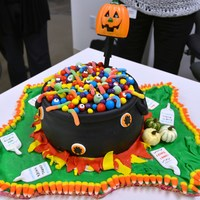 Witch Cauldron - Halloween Its a chocolate cake with chocolate frosting with fondant accents, candy corn, Wrigley eyes, worms etc...Intentionally made the fondant...