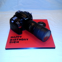 Nikon D7000 Camera Cake Chocolate Fudge Cake, Vanilla Butter cream Icing, Used poured sugar for the Lens, View finder and red eye flash.