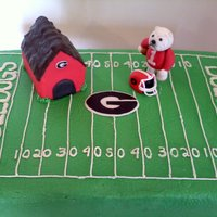 Georgia Bulldogs   Everything is edible. Doghouse is rkt covered in fondant. Hope you enjoy! TFL!