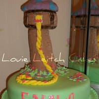 Tangled Tower   Tangled / Rapunzel cake which consist of a vanilla sponge and buttercream base and a krispy treat tower.