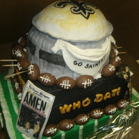 New Orleans Saints Superdome Grooms Cake rice krispy superdome covered in fondant gumpaste decorations, lol toothpicks just holding footballs till the royal dries...made this for...