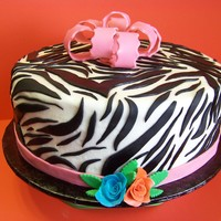Zebra Zebra print in fondant. Frosting is butter cream. Bow is gumpaste fondant mix.