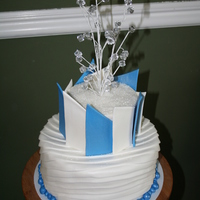 Blue And White Icy Look Wedding Cake Fondant covered cake with crystal bead middle
